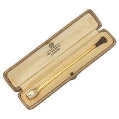 Asprey London, an 18 Karat Gold, Platinum, and Diamond Cigarette Holder