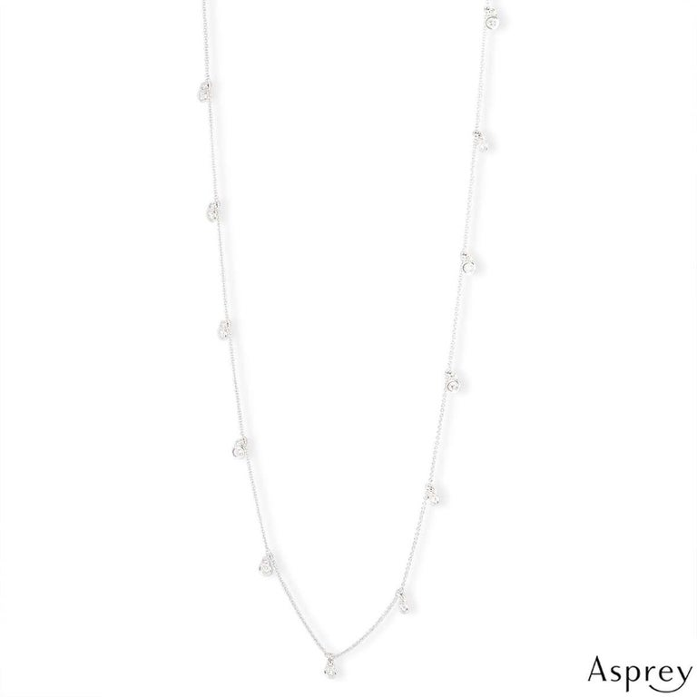 A beautiful 18k white gold necklace by Asprey. The necklace features 13 round brilliant cut diamonds in a rubover setting, spread throughout the chain. The diamonds have a total weight of 2.05ct. The necklace measures 36 inches in length and has a