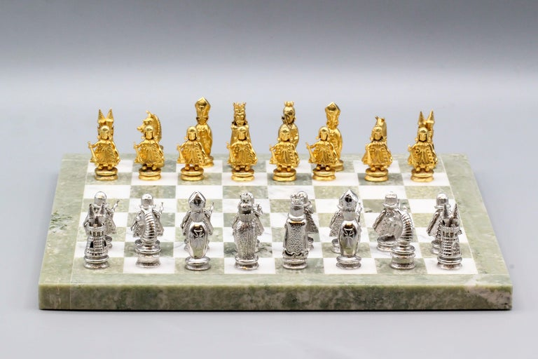 Very fine and rare chess set by Asprey, circa 1960s.  The set features 32 9k yellow and white gold pieces with a marble board.  Comes with its own carrying case.   Hallmarks: A.C.Co. 9 375, British assay marks