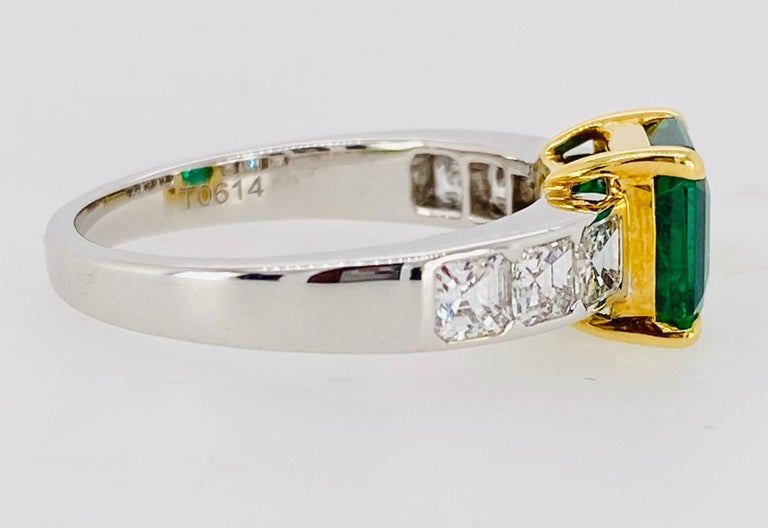 A single, Asscher cut Emerald accented with six graduated Asscher cut Diamonds is set in a hand fabricated, 18k white and yellow gold setting. Certified, Vivid Color Emerald.  Emerald:  1.95 carats, approx 7mm x 7mm Six Asscher cut Diamonds, 4mm,
