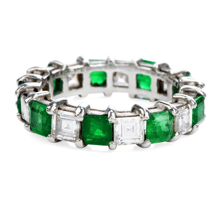 Acelebration of beauty and endless sparkle! Finely crafted in solid platinum, this eternity band feature 9 genuine emerald cut emeralds approx. 2.06 carats and 9 asscher-cut diamond approx. 1.45 carats F-G color VS1 clarity. This remarkable band