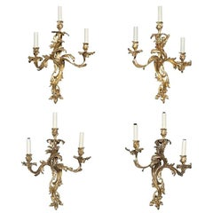 Assembled Set of Four Louis XV Style Gilt Bronze Three-Light Wall Lights