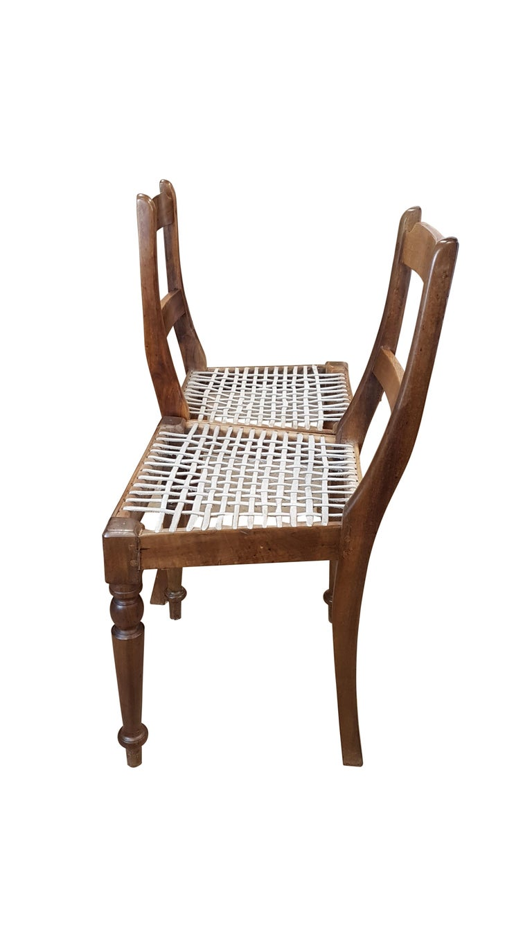 A very nice and unique near pair of late Victorian colonial teak chairs with leather strapped chairs. They have old repairs in places and the front legs have a few differences in the turning. They have developed a good patina of age will a warm