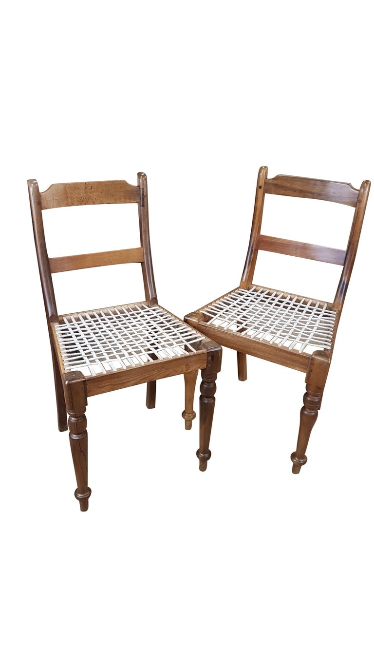 Patinated Associated Pair of Late Victorian Colonial Chairs For Sale