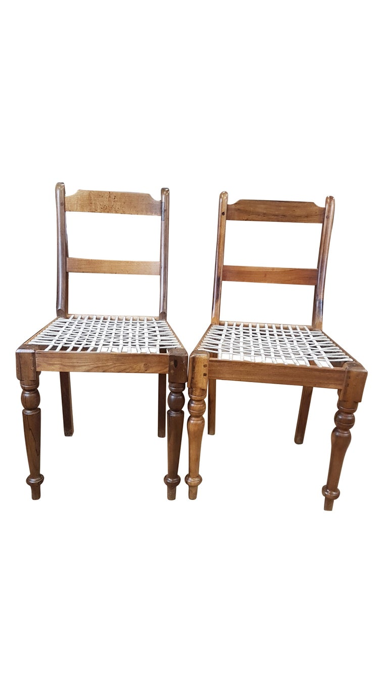 Associated Pair of Late Victorian Colonial Chairs In Distressed Condition For Sale In Bodicote, Oxfordshire