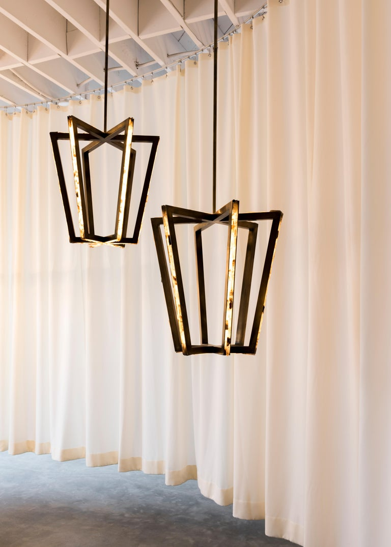 Reworking the concept of the traditional lantern, Asterix is inspired by the potentials offered by extrusion of the asterisk keyboard character. Slices of LED emanate from brass, setting the standard in 21st century architectural