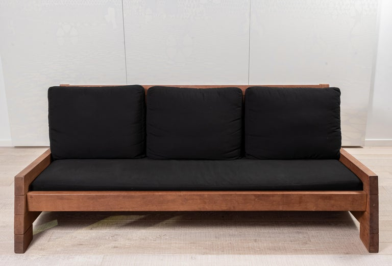 The Asturias sofa is a clean statement to any space. Carlos Motta designed this line of furniture using reclaimed and post •demolition wood. • Base structure made of Itauba Preta wood • Suitable for both indoors and outdoors.