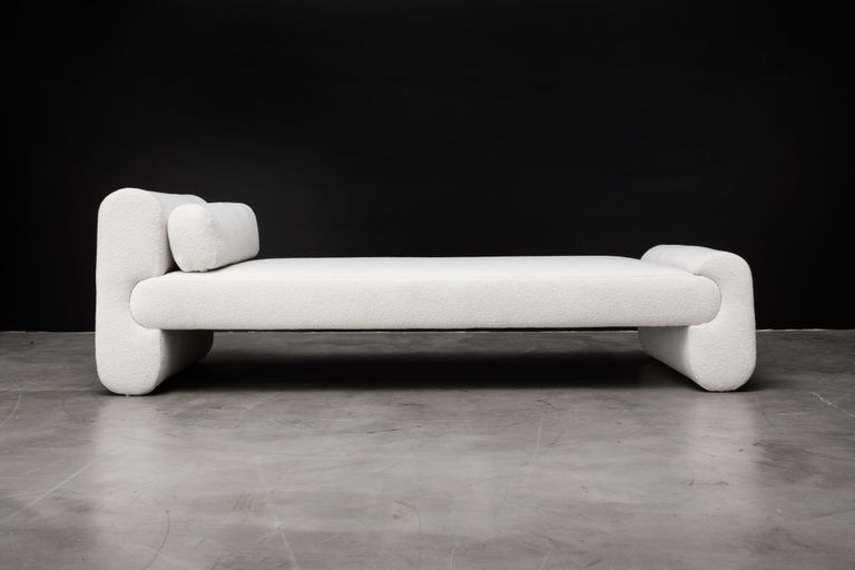 The Asym day bed features asymmetrical design elements that are both sophisticated and simple. The unbalanced tension of the piece works beautifully together to make a minimal and elegant design statement. The displayed fabric is our warm and