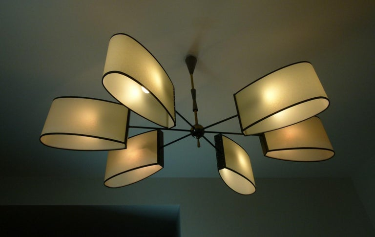 Asymmetrical chandelier with six lighted arms by Maison Lunel, circa 1950 8