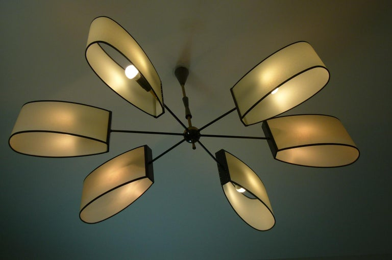 Asymmetrical chandelier with six lighted arms by Maison Lunel, circa 1950 10