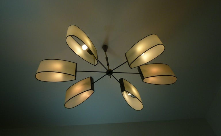 Mid-Century Modern Asymmetrical chandelier with six lighted arms by Maison Lunel, circa 1950