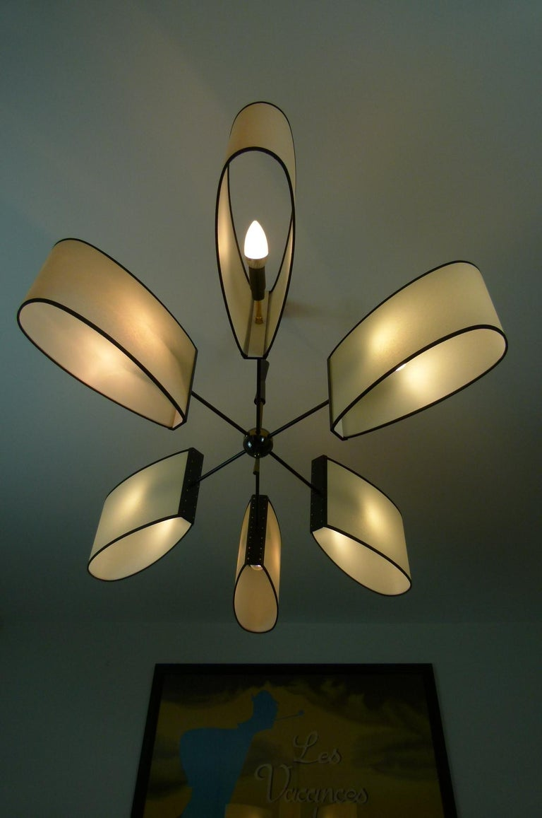French Asymmetrical chandelier with six lighted arms by Maison Lunel, circa 1950