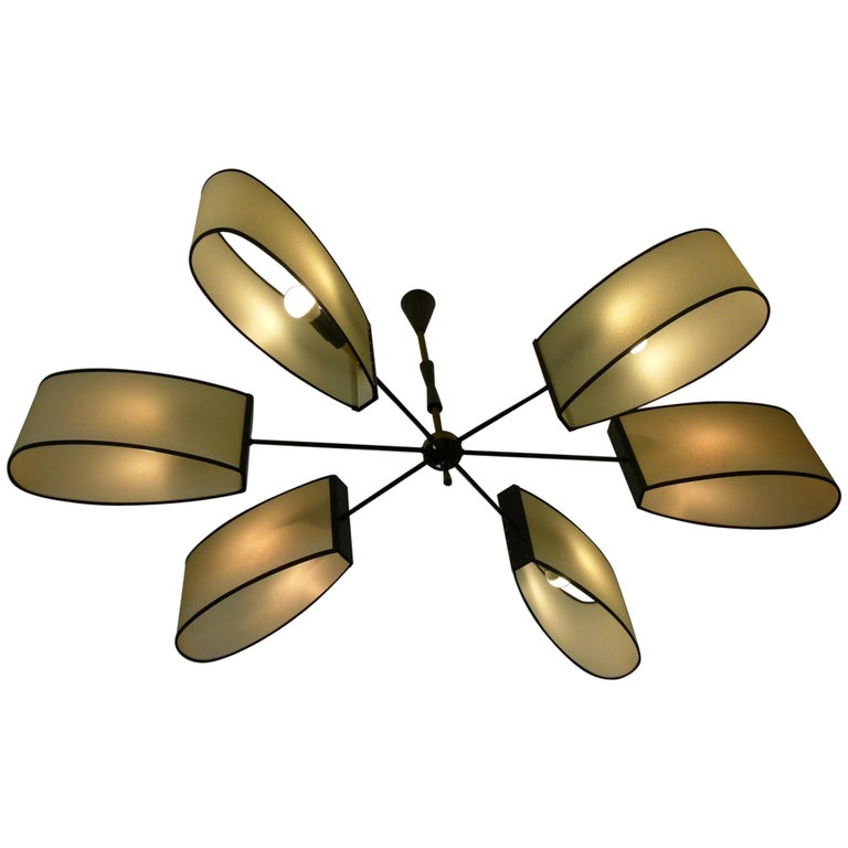 Asymmetrical chandelier with six lighted arms by Maison Lunel, circa 1950