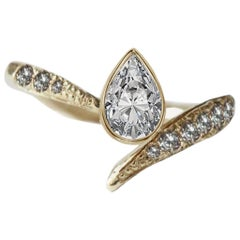 Asymmetrical Engagement Pear Diamond Ring in 18 Karat Yellow Gold