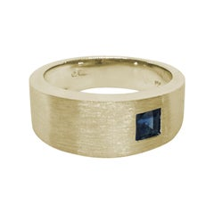 Asymmetrically Set Solitaire Sapphire Yellow Gold Ring