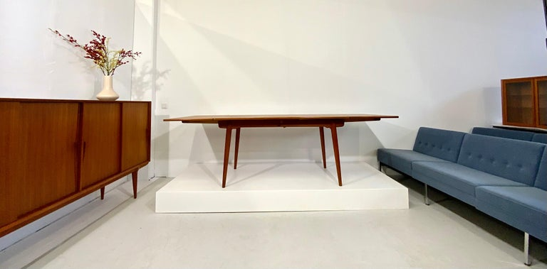 This Danish modern vintage furniture and teak dining table classic was designed in 1950s by the well-known designer for Danish furniture's Hans Wegner for the cabinetmaker Andreas Tuck in Denmark. This dining table is from highest quality, a