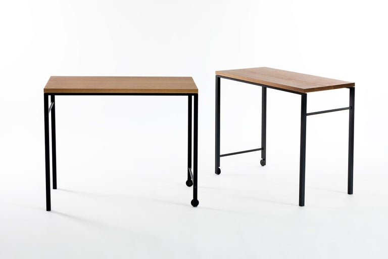 """Whether used as an occasional table, a writing desk or cart, the AT16's clean lines and crafted materials offer a graceful solution for the home or office.  Shown in solid white oak and blackened cold-rolled steel.  Dimensions: 36"""" W x 29.75"""" H"""