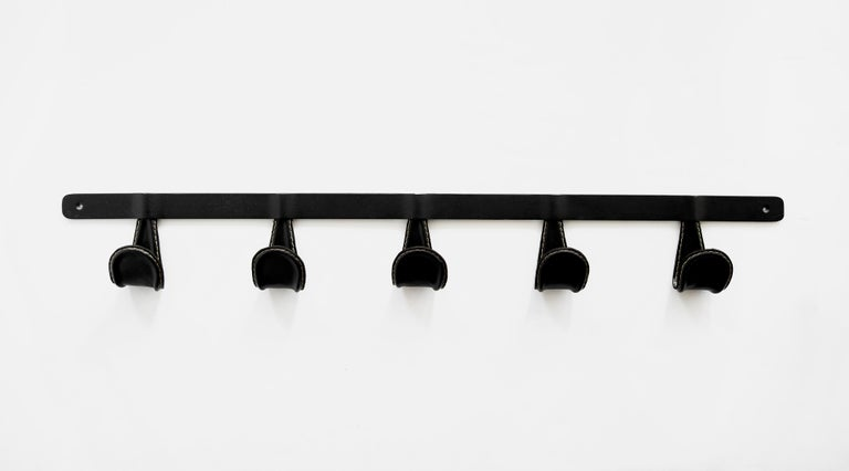 Newly produced iron and leather coat rack. Iron hooks wrapped in black leather with contrast stitching. Leather options available.