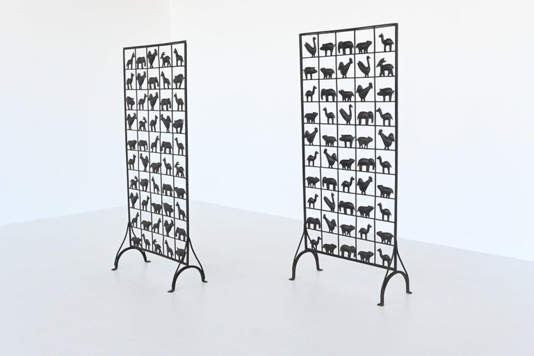 Beautiful and highly decorative screens designed and manufactured by Atelier Marolles, France, 1950. These screens are made of wrought iron and decorated with 50 animal figures. Very nice to divide spaces but not completely close them. The screens