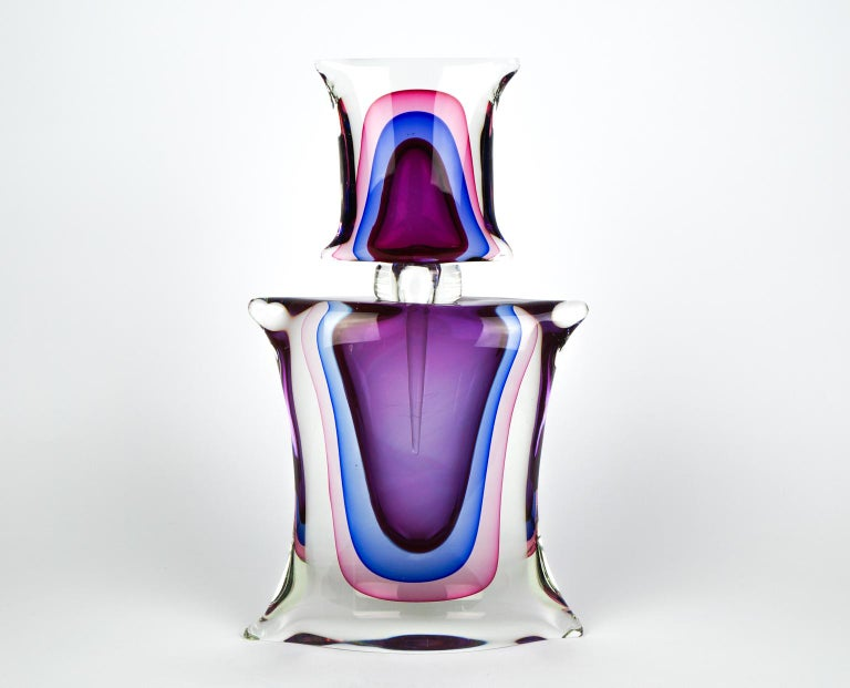 Pair of Murano blown glass bottles, handmade with Sommersa work, amethyst, blue, pink and crystal color.  Works performed by the famous Vetreia Oball Murano in 1994s.  The conditions are perfect. The glass is very thick. To complete its