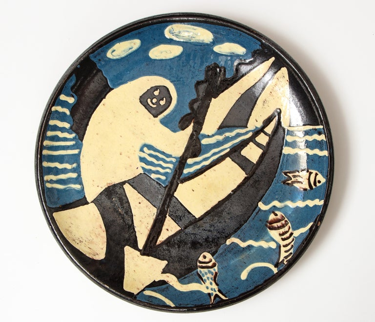 Atelier Primavera ceramic platter depicting smiling rower in canoe, France, early 20th century.