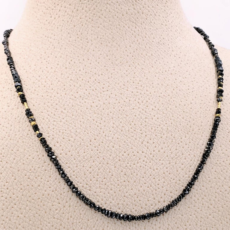 One of a Kind Necklace handcrafted by renowned jewelry artist Atelier Zobel (Peter Schmid) featuring 10.51 total carats of assorted faceted black diamonds, 24k gold Nepalese beads, and handmade faceted silver elements with a handmade oxidized silver