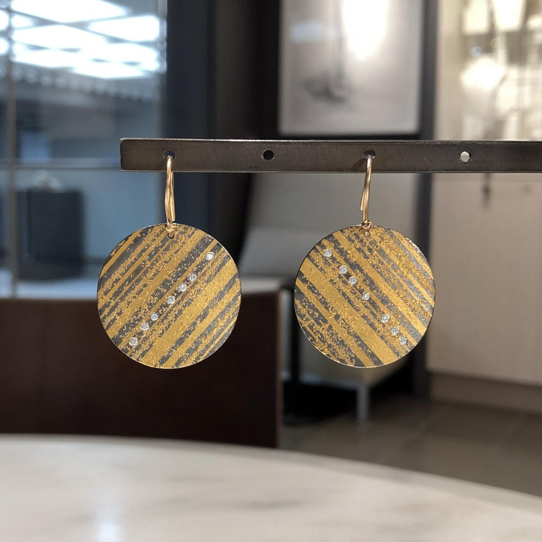 One of a Kind Curved Disc Drop Earrings hand-fabricated in 2019 in Germany by award-winning jewelry maker Atelier Zobel (Peter Schmid) in 24k and 18k yellow gold and oxidized sterling silver with fourteen round brilliant-cut diamonds totaling 0.14