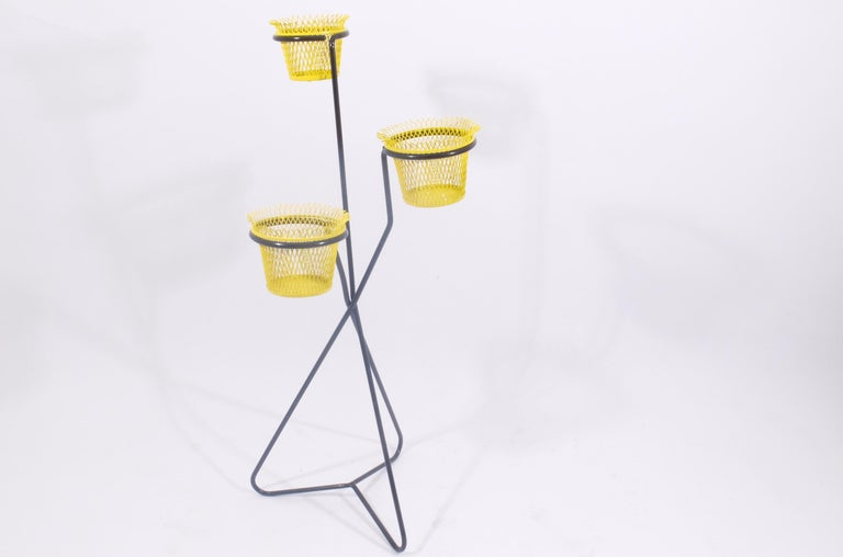 Triple plant stand in yellow and black. Manufactured by