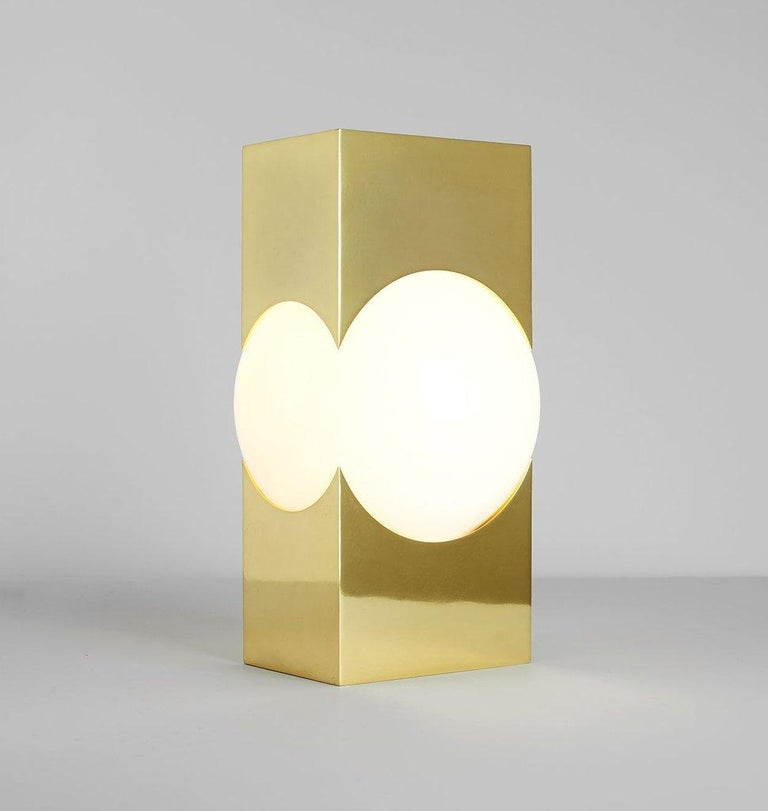 Named for the Titan doomed to shoulder the world, Atlas combines an illuminated glass globe with an intersecting metal armature, drawing on Karl Zahn's elegant use of geometry and metaphor in design.  Please note that the item title reflects the