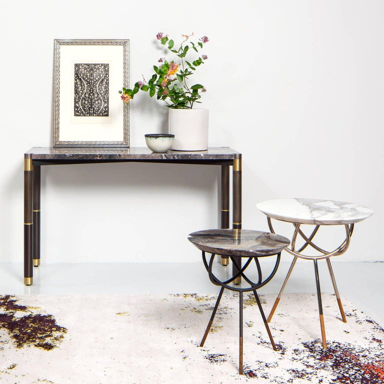 """The Atlas table consists of a 1 1/4"""" thick chamfered stone top resting on a delicately trellised solid brass base with hardwood feet.   Avram Rusu Studiois a Brooklyn based design studio known for impeccably crafted and distinctly sculptural work."""