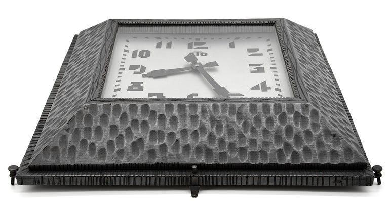French Art Deco wall clock by ATO (Paris), France, circa 1930. Wood and metal. The frame is made in wood and imitates the metal. Original external adjustment screws. Measures: Height 16.5