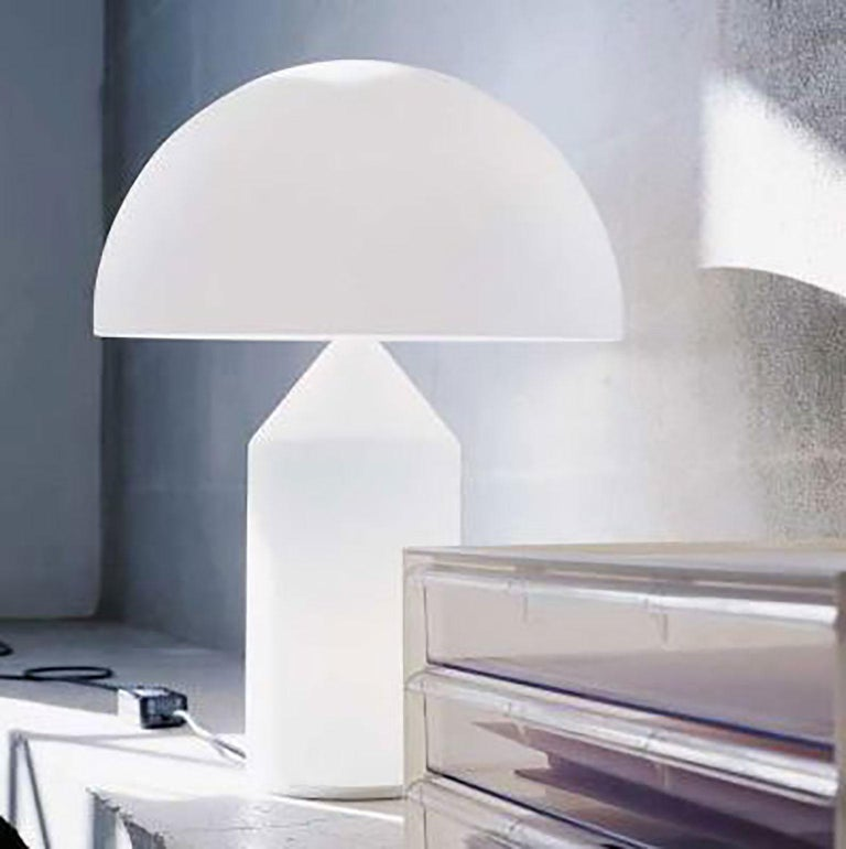 Atollo Table Lamp by Vico Magistretti for Oluce. The Atollo lamp has become an iconic representation of the table lamp. The simple cylinder,  cone, and hemisphere combine in such a simple but strong way highlighting form follows function. The shade