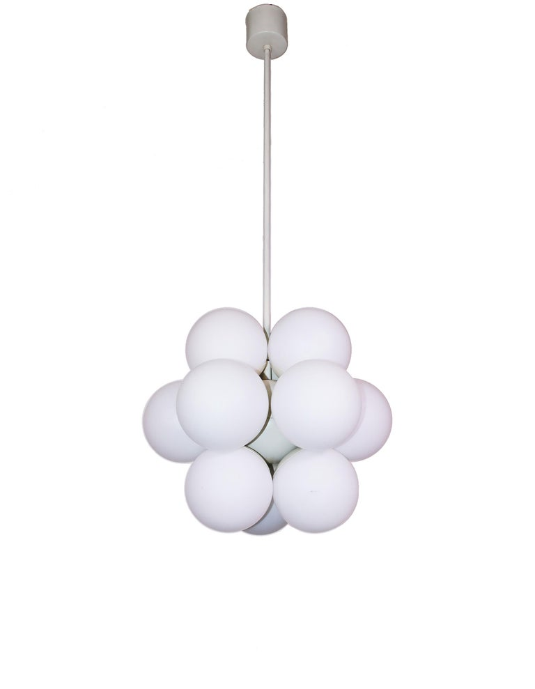 Kaiser atomic chandelier with twelve white opal glass balls on a white metal frame, made in Germany in the 1960s. Very good condition with all original components. The lamp takes twelve small Edison bulbs. Measures: Diameter 15.7 in. / 40 cm,