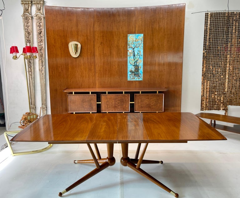 American Mid-Century Modern expandable dining table with extraordinary base which appears to defy gravity. I need my 10th grade geometry teacher to explain the theorem behind this amazingly sculptural structure which resembles a tetrahedral