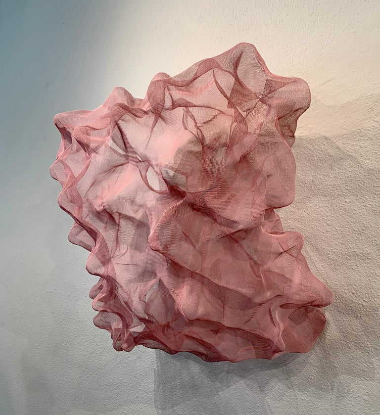 Cotton Candy Cloud, Atticus Adams Pink Metal Mesh Sculpture Screen  This piece can be hung from the ceiling, hung from a wall, or used on a pedestal or table.  Metal fiber sculpture that incorporates fascinating light and shadow into its