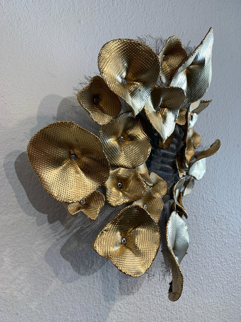 Flora Narcissus - Golden Hydrangea, Atticus Adams Mesh & Mirror Wall Sculpture  Metal fiber sculpture that incorporates a mirror, fascinating light and shadow into its form.  NOTE:  This piece can be combined with the OTHER Flora Narcissus pieces to