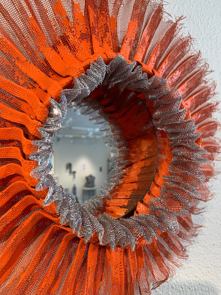 Flora Narcissus - Orange Silver Ruff, Atticus Adams Mesh & Mirror Wall Sculpture  Metal fiber sculpture that incorporates a mirror, fascinating light and shadow into its form.  NOTE:  This piece can be combined with the OTHER Flora Narcissus pieces