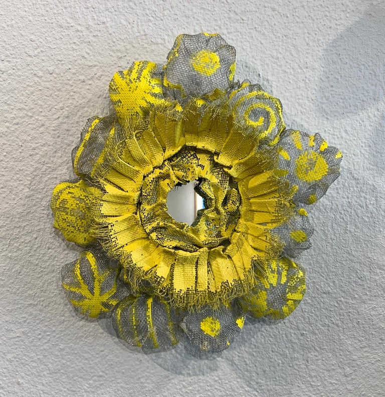 Flora Narcissus - Yellow Burst, Atticus Adams Metal Mesh & Mirror Wall Sculpture  Metal fiber sculpture that incorporates a mirror, fascinating light and shadow into its form.  NOTE:  This piece can be combined with the OTHER Flora Narcissus pieces