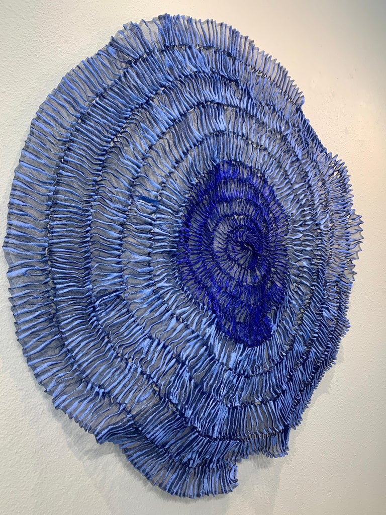 """Sujoon II (Cornflower & Cobalt), Atticus Adams Mesh Wall Sculpture Screen Shadow  Metal fiber sculpture that incorporates fascinating light and shadow into its form.  From Atticus Adams:  """"I like to think of my work as Neo-Appalachian Folk"""