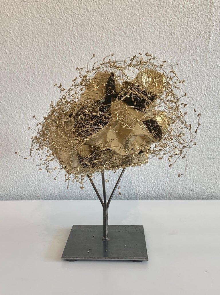 """The Gathering Gilded, Atticus Adams Gold Metal Mesh Standing Sculpture with Black Stand  Metal fiber sculpture that incorporates fascinating light and shadow into its form.  From Atticus Adams:  """"I like to think of my work as Neo-Appalachian Folk"""
