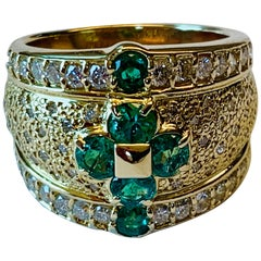 Attractive and Unusual 18 Karat Emerald and Diamond Ring