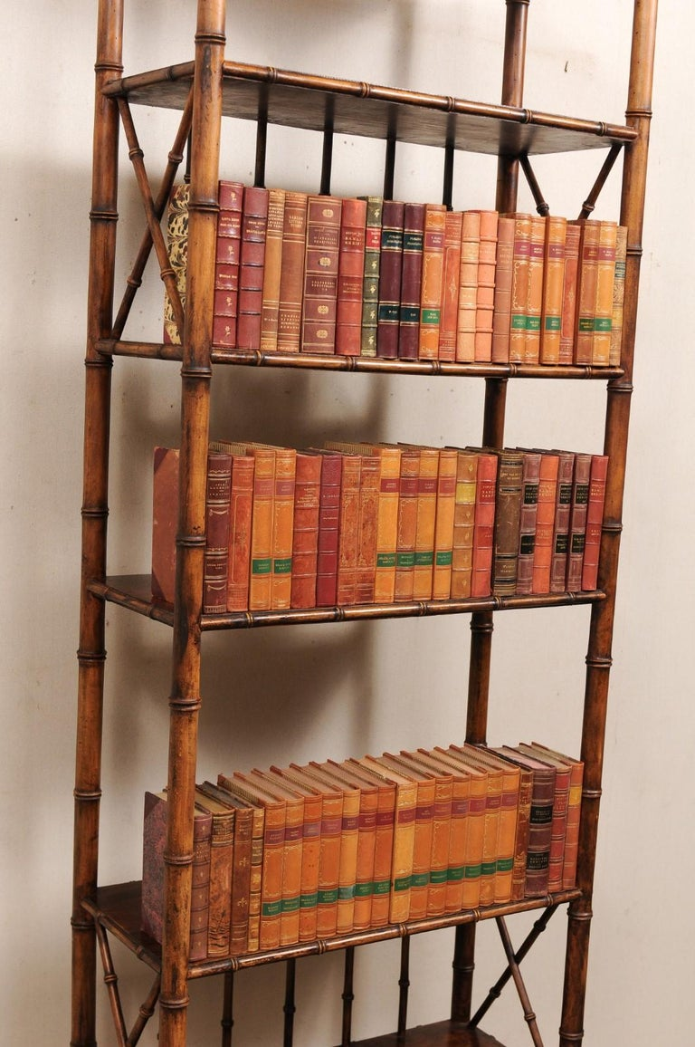 An attractive collection of 100 Swedish antique leather-bound books. This set of 1920s literature books from Sweden are wrapped in leather-bound covers, comprised of varying rich, warm tones and gold leaf print embossing. The books seated