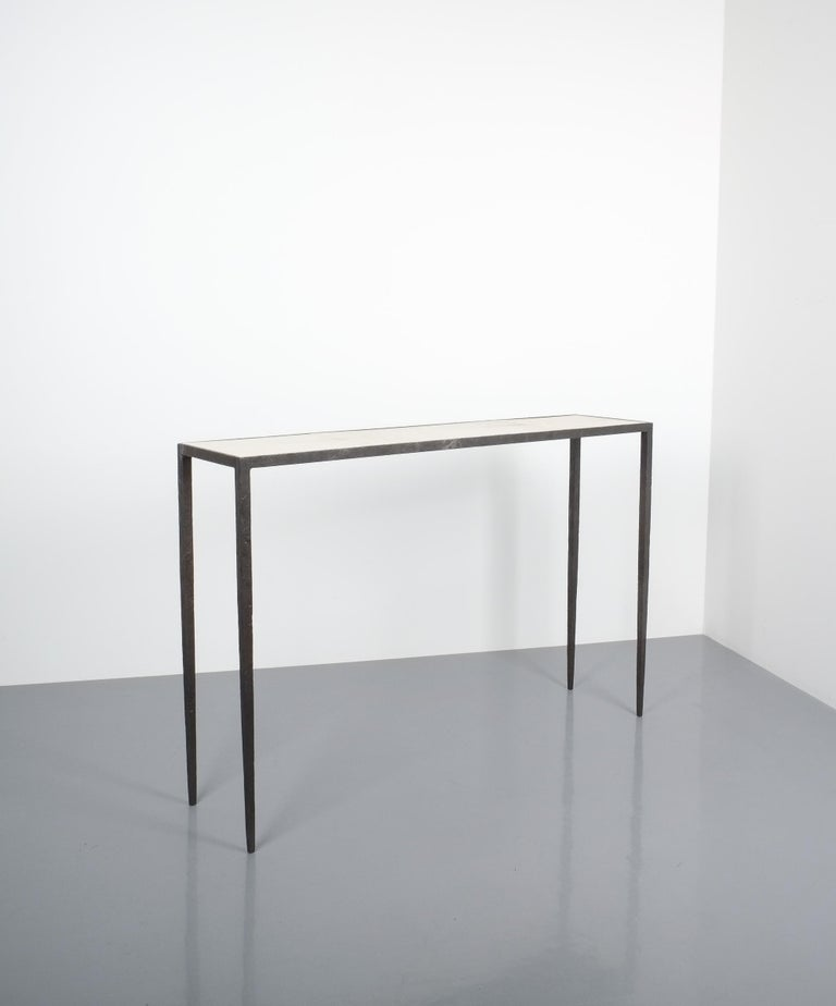 Literature: Leopold Diego Sanchez, Jean-Michel Frank, Editions du Regard, pg.145  Attributed Jean-Michel Frank forged wrought iron console table, France. Slender solid wrought iron base with a parchment paper surface and beautiful iron work, all