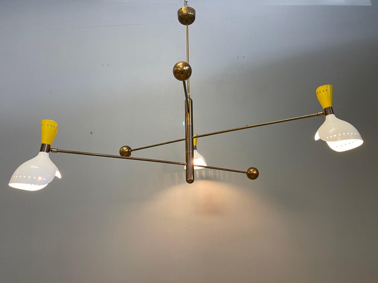 Fantastic rare chandelier attributed Stilnovo. Composed of three adjustable arms with counter weight. Made of brass and metal lampshades.