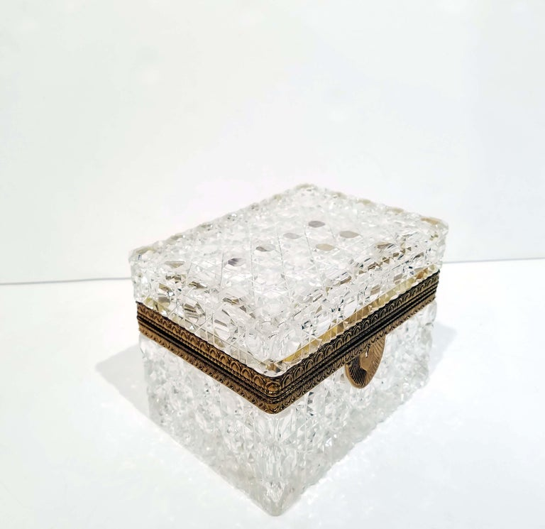 Cut crystal jewelry box with bronze mounts, circa early 20th century. Good condition with some age oxidization to bronze mounts. Measures: 5.5