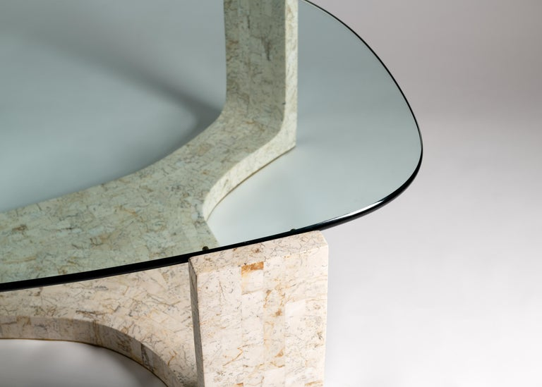 This marvelously amorphous table of glass and off-white veneer is not merely striking--it's remarkable for how little visual space it consumes despite its ample, practical size.