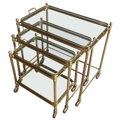 Attributed to Maison Baguès, Set of Neoclassical Brass Nesting Tables on Casters