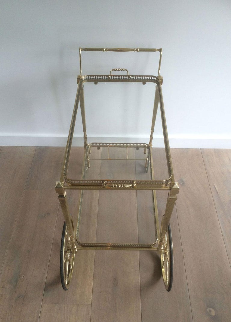Attributed to Maison Jansen. Neoclassical Brass Bar Cart with Removable For Sale 11