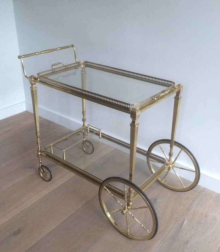 Attributed to Maison Jansen. Neoclassical Brass Bar Cart with Removable For Sale 14