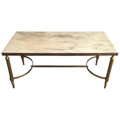 Attributed to Maison Jansen. Neoclassical Brass Coffee table with marble top
